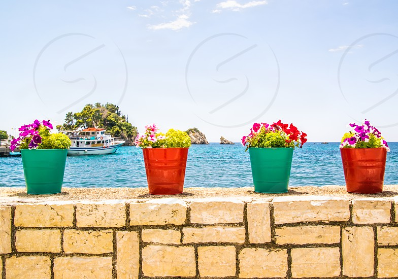 Colorful Flower Pots At Seascape In Parga Greece photo