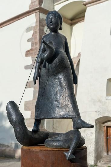 BISTRITA TRANSYLVANIA/ROMANIA - SEPTEMBER 17 : Modern sculpture in front of the Lutheran Church in Bistrita Transylvania Romania on September 17 2018 photo