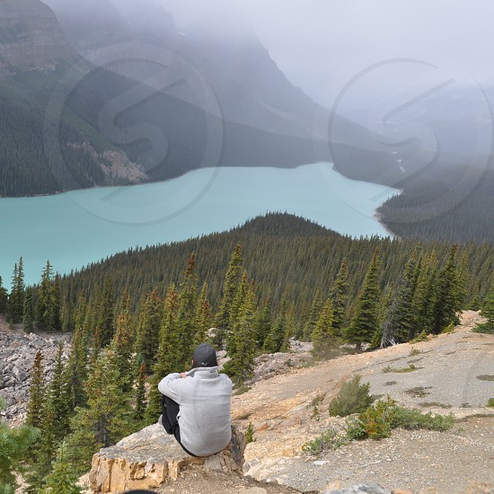 peaceful moment overlooking a mountain lake in Alberta  Canada photo