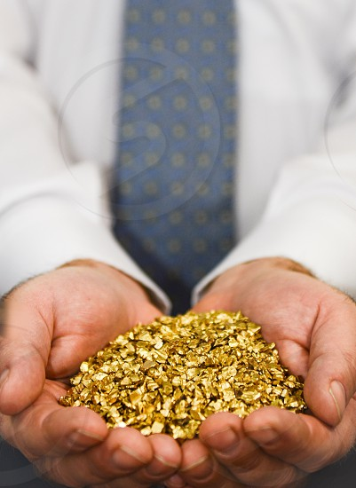 Man holding pieces of gold photo