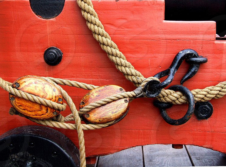 Ropes pullys and hooks on a ship. photo