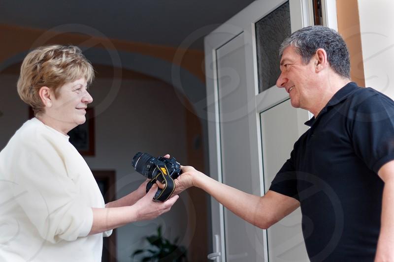 man women maturegift object postal entrance delivery photo