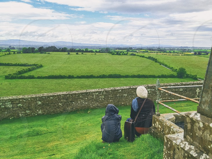 Woman and child in Ireland looking out at fields photo