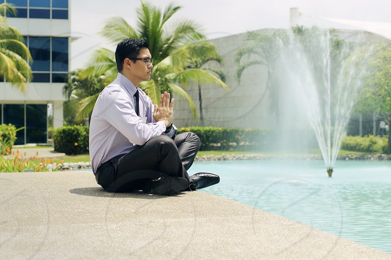 meditating business businessman work worker zen yoga adult asian building businesspeople calm chinese city concentrated concentration corporate crossed crossed legs entrepreneur happy legs lotus male man meditation office outdoor Panama people person position prayer relax relaxing serene sitting street stress stressed success suit tranquil water wide shot working workplace young zen-like photo