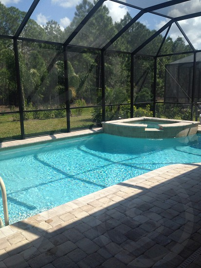 outdoor pool with black net cover photo