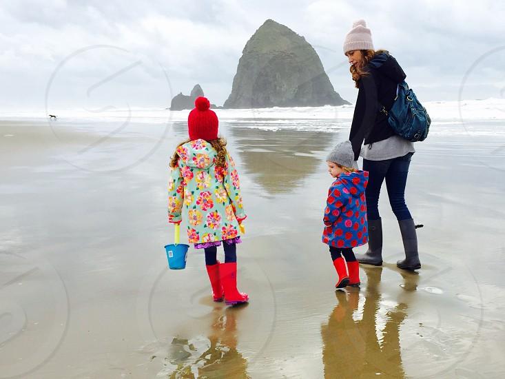 Family at cannon beach on the Oregon coast.  photo