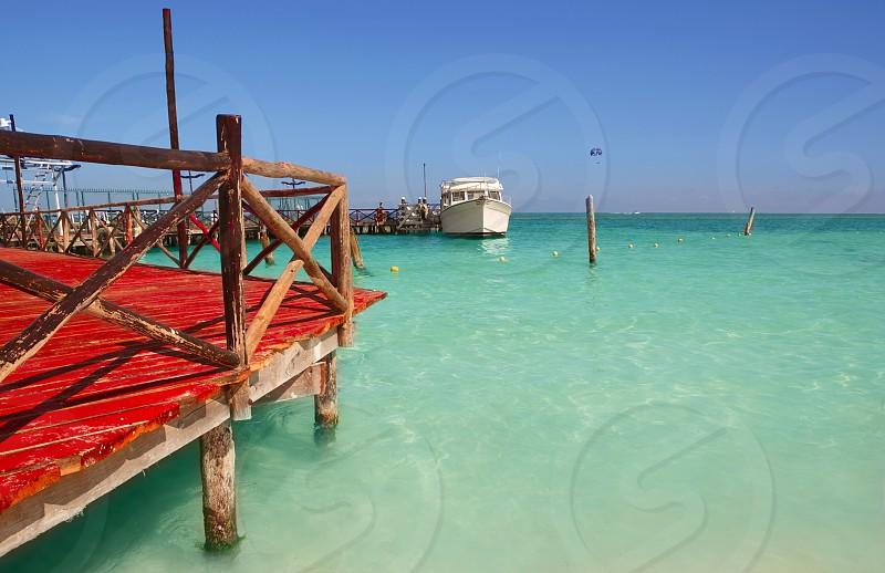 caribbean sea wooden dock mooring in Cancun Mexico photo