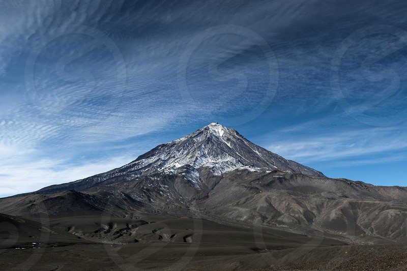 Mountain landscape: view on active Koryak Volcano (Koryaksky Volcano) beautiful clouds and blue sky. Kamchatka Peninsula Far East Russia. Koryaksky-Avachinsky Group of Volcanoes. photo