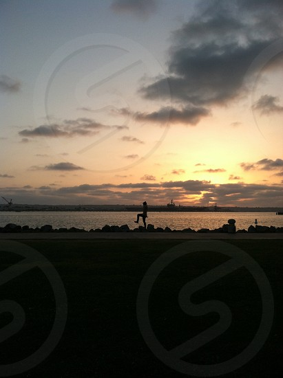 scene at sunset with waterfront photo