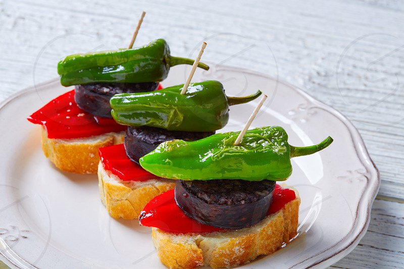 pinchos Burgos morcilla with padron pepper tapas pintxos from Spain food photo