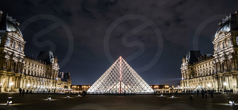 The Louvre's Pyramid in Paris at night photo