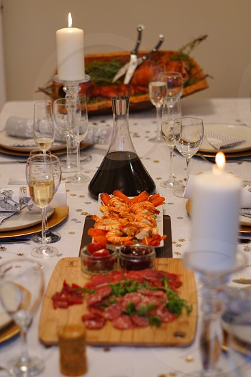 Table set for special occasion with lit candles and lovely food photo