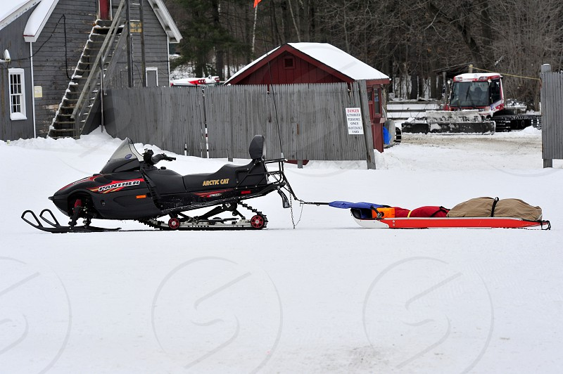 Snowmobile rescue at the slopes photo