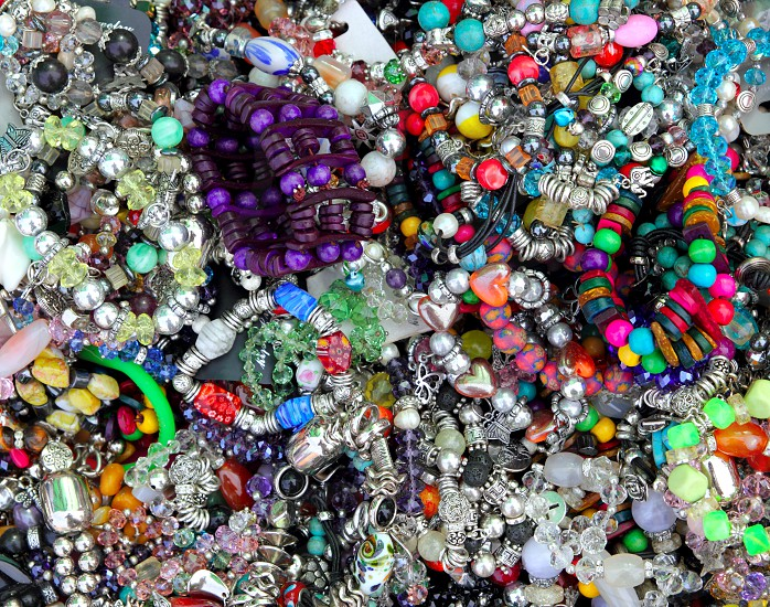 colorful jewellery mixed mess in a retail market shop photo