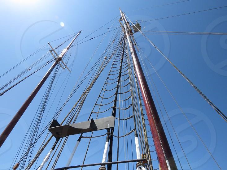 mast sailing blue sky sun wood landscape adventure photo
