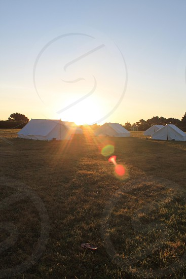 white tents on green field photo
