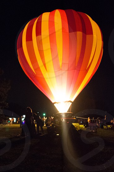 red and orange hot air balloon photo