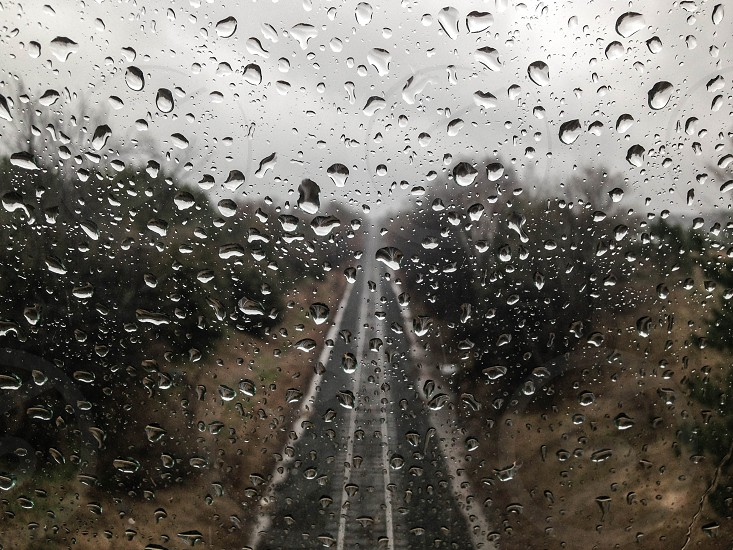 Railroad tracks thru raindrops photo