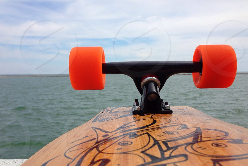 brown and orange skateboard photo