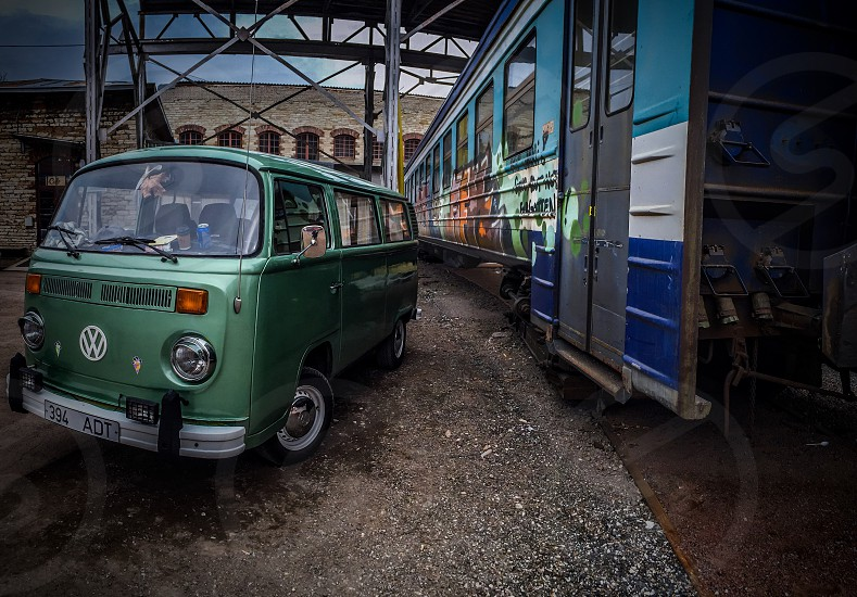 Outdoor day horizontal landscape colour filter van VW camper automobile transport train carriage soviet Baltic green blue Tallinn Estonia Europe European travel vintage photo