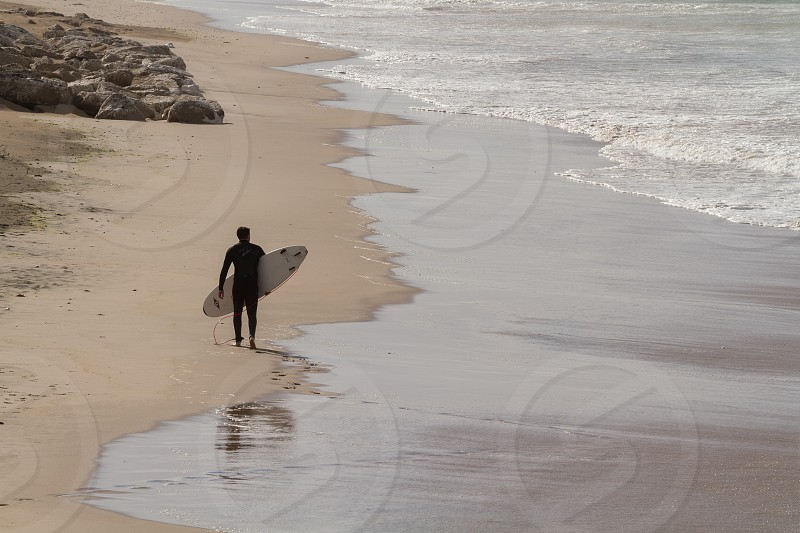 A man surfing along the coast of Ireland photo