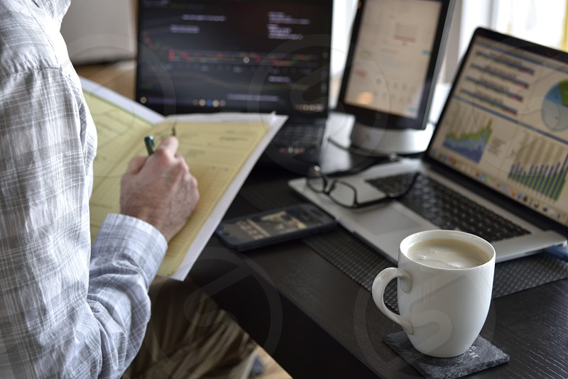 Home office contract signing coffee data screens working man photo