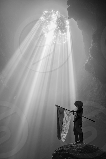 human with country  flag in cave photo