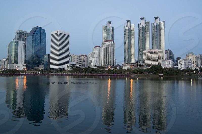 the skyline at the Ratchada Lake at the Ratchada Park in the city of Bangkok in Thailand in Southeastasia.  Thailand Bangkok November 2018 photo