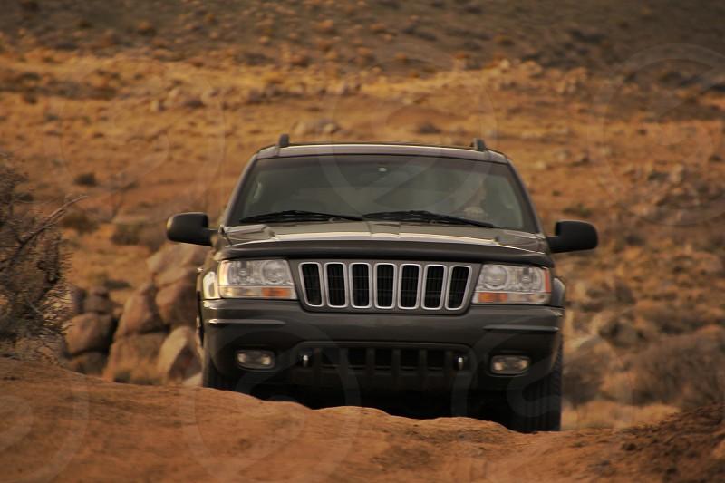black jeep cherokee on the road photo