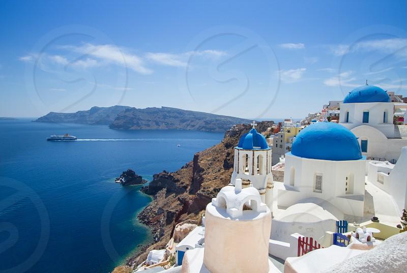 Santorini Greece blue domes Aegean sea photo