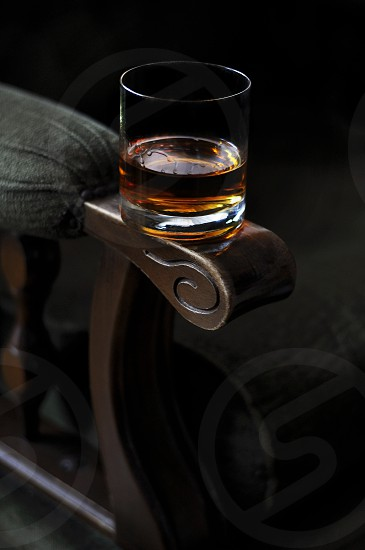 Glass of Whisky at Vintage Armchair photo