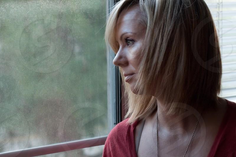 woman staring at window photo