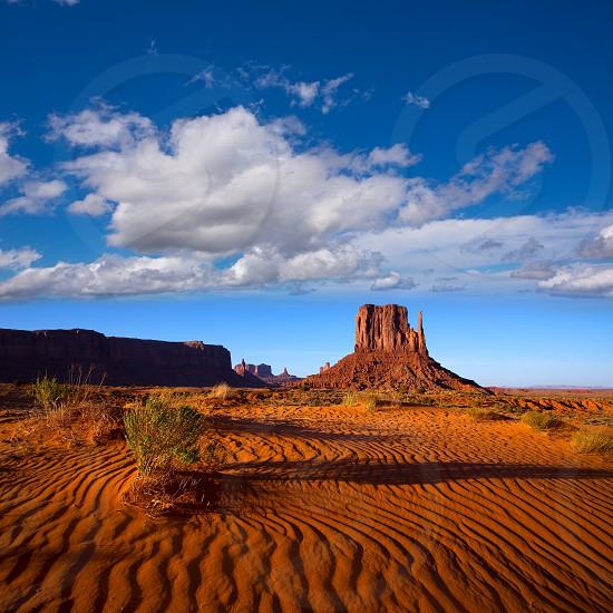Monument Valley West Mitten Butte with desert sand dunes Utah photo