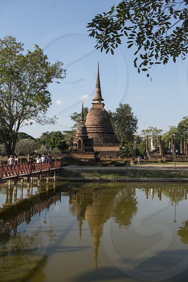 a stupa at the Wat Sa Si Temple at the Historical Park in Sukhothai in the Provinz Sukhothai in Thailand.   Thailand Sukhothai November 2018 photo