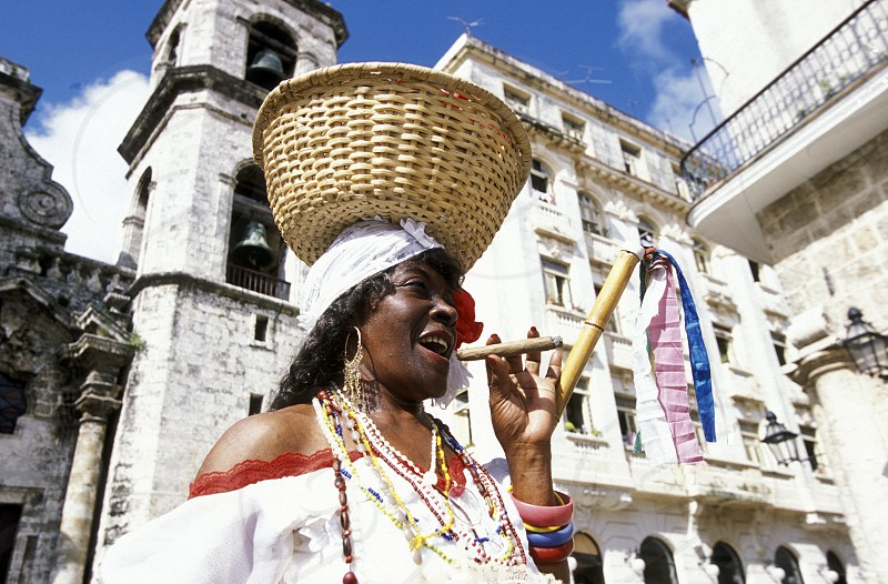 a women at the Plaza de la Catedral in the old town of the city Havana on Cuba in the caribbean sea. photo