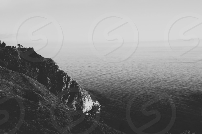 Coast ocean horizon foggy water cliff photo