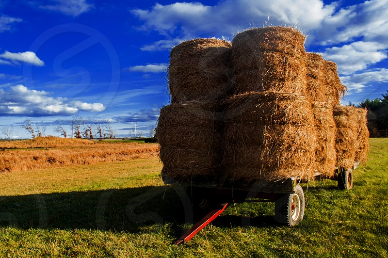 Hay wagon landscape fall autumn blue skies clouds photo