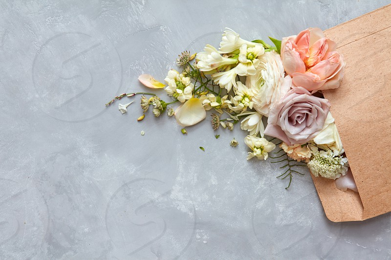 envelope with flowers on the stone gray background. flat lay photo