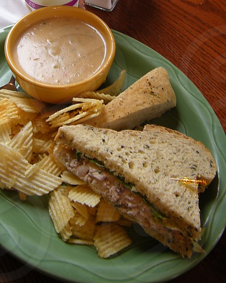 Asiago cream soup and chicken salad sandwich with potato chips photo