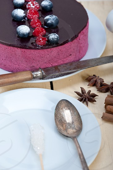 blueberry and raspberry cake mousse dessert with spice  photo