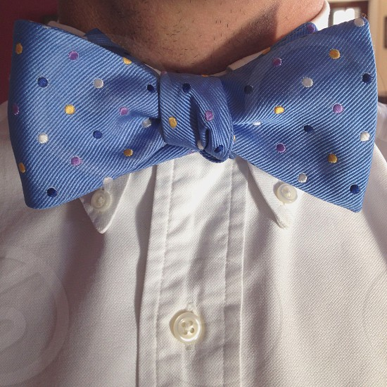Blue bow tie with yellow blue white polka dots photo