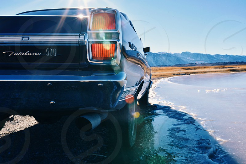 ford fairlane 500 parked by water photo
