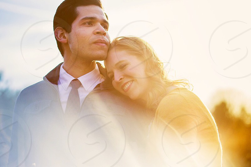 Faded cinematic prisming couple engagement portrait editorial sunset smile happy intimate color contrast natural light photo