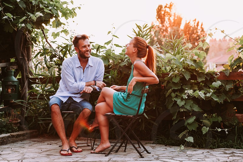 Young couple in love enjoying on a terrace photo