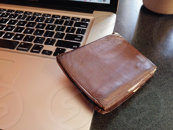 brown leather bi fold wallet photo