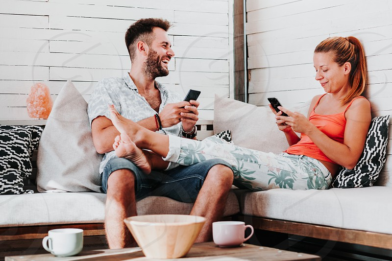 Couple relaxing in the living room photo