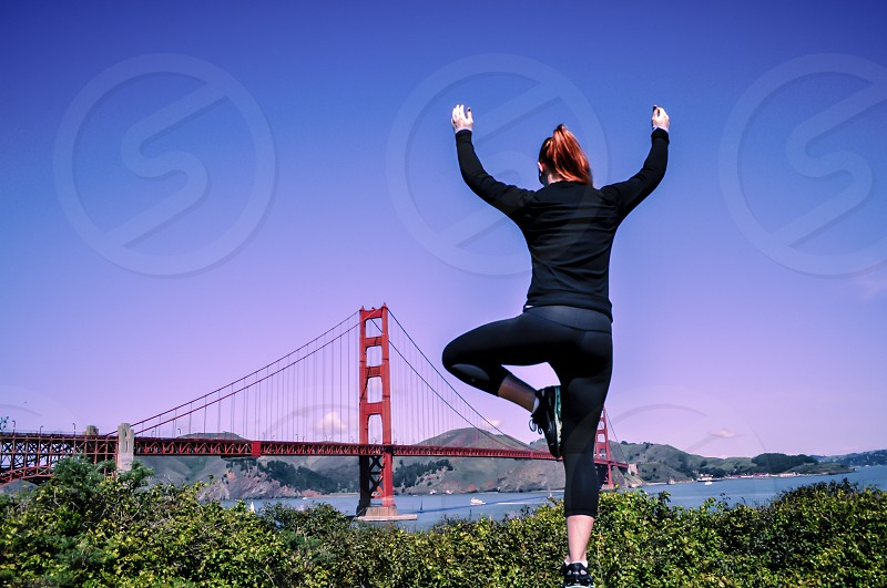 Tree pose in front of the Golden Gate Bridge. photo