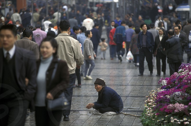 People at the main square in the city of Chongqing in the province of Sichuan in china in east asia.  photo
