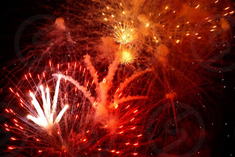 Fireworks sky explosion fire bright night celebration  photo