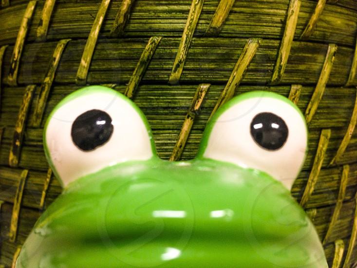 green ceramic figure photo